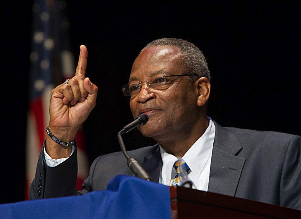 man in a public speaking